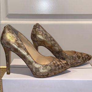 Ivanka Trump snake skin pointed toe heels